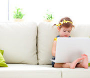 stock-photo-85016181-child-girl-with-a-laptop-at-home